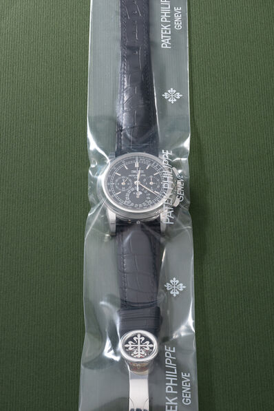Patek Philippe, 'A rare and highly attractive platinum perpetual calendar chronograph wristwatch with moonphases, additional caseback, setting pin, certificate of origin and box, factory sealed', Circa 2009