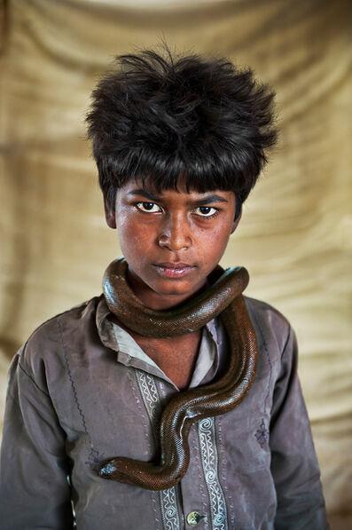 Steve McCurry, 'Boy with Sand Boa. Gujarat, India', 2009