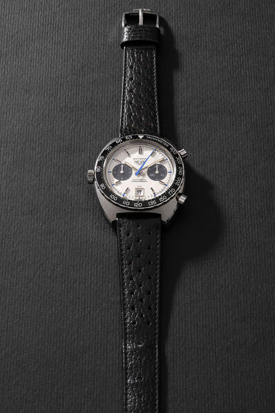 Heuer, 'A rare and attractive stainless steel chronograph wristwatch with silver dial, black registers and date', Circa 1970