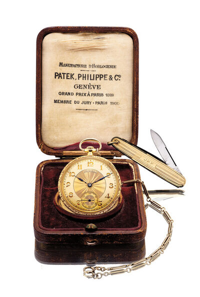 Patek Philippe, 'A fine and attractive yellow gold chased and engraved openface pocket watch with watch chain, gold knife and presentation box', 1921