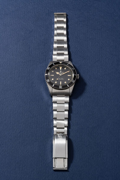 "Rolex, 'An extremely attractive and rare stainless steel wristwatch with center seconds, no crown guards, ""exclamation mark"" black glossy dial and bracelet', Circa 1962"