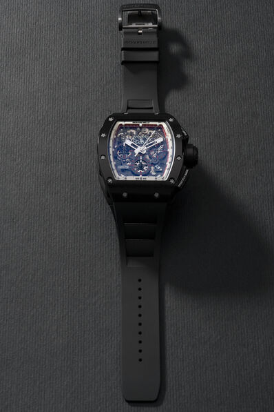 Richard Mille, 'A highly attractive and very rare limited edition carbon tonneau-shaped flyback chronograph wristwatch with date, original warranty and presentation box, limited edition of 10 pieces, specially made for the Japanese market', Circa 2014