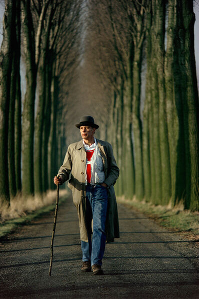 Gerd Ludwig, '#4 - Joseph Beuys walks down an alley of poplar trees in the Düffel area', 1978