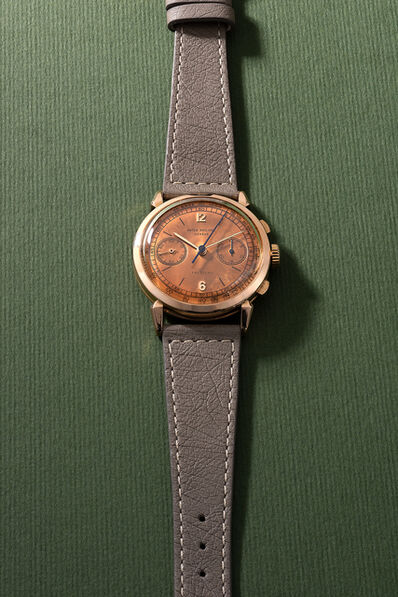 """Patek Philippe, 'A very attractive and rare pink gold chronograph wristwatch with """"spider"""" lugs, tachymeter scale, original certificate and box, retailed by Freccero', 1949"""