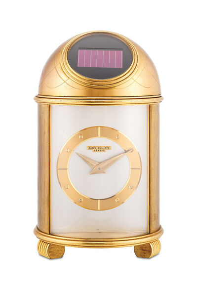 Patek Philippe, 'A fine and rare engraved gilt brass solar powered dome clock with presentation inscription', 1965