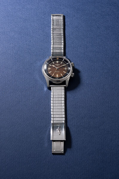 Longines, 'A rare and attractive stainless steel diver's wristwatch with bracelet, sweep center second, inner rotating bezel and tropical dial', 1966