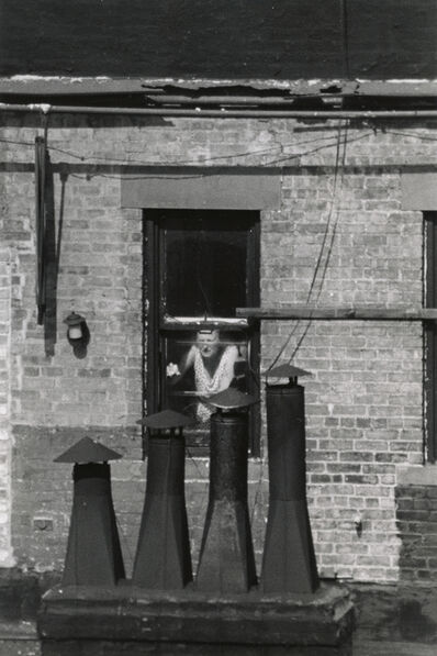 André Kertész, 'Woman at window with chimneys', 1970