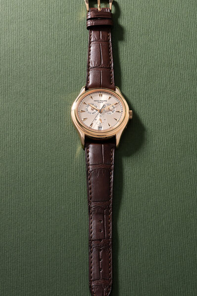 Patek Philippe, 'A fine and rare limited edition pink gold wristwatch with annual calendar, sweep center seconds, original certificate and box, made to commemorate the 100th anniversary of A. C. Milan, numbered 89 of a limited edition of 100 pieces', 1999