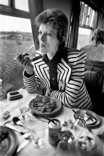 Mick Rock, 'Bowie Eating on Train', 1973