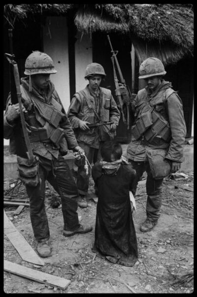 Don McCullin, 'US Soldiers Tormenting a Civilian in the Old City of Hue During the Offensive, Tet, Hue', 1968