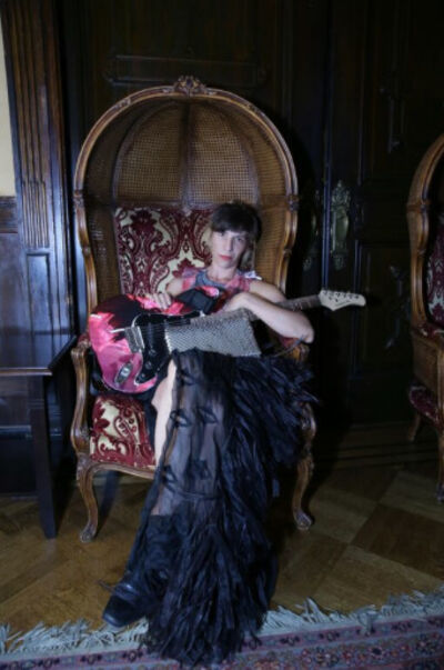 Agathe Snow, 'Agathe Snow wearing ART CAPSUL T-Shirt Cocktail Dress with Bad Girls Limited Edition Guitar Handbag'