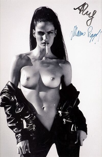 Mert and Marcus, 'Woman in an open black overall', years 1990