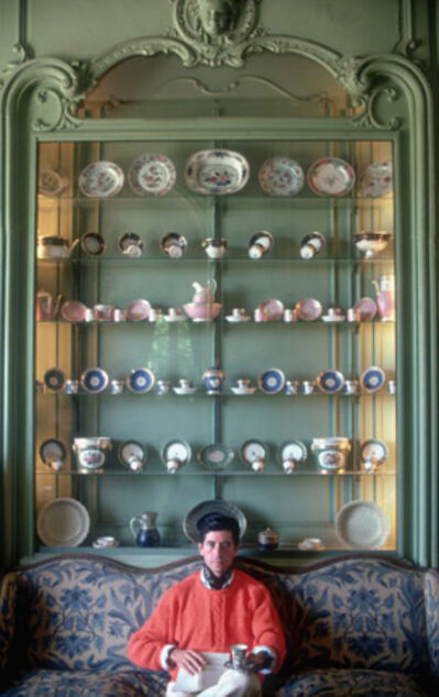 Slim Aarons, 'Comte d'Arcangues, 1986: Michel, Comte d'Arcangues, against a wall of Servres and Compagnie de Indes porcelains at his Chateau d'Arcangues, Biarritz, France', 1986