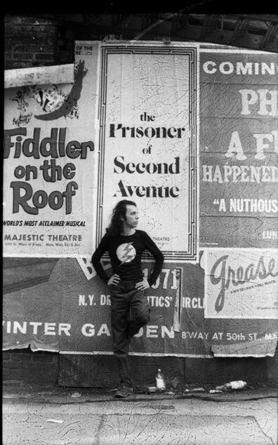 Hélio Oiticica, 'Hélio Oiticica in front of a poster for Neil Simon's play The Prisoner of Second Avenue, in Midtown Manhattan', 1972