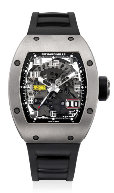 Richard Mille, 'A highly attractive titanium skeletonized tonneau-shaped wristwatch with date, original warranty and presentation box', Circa 2015