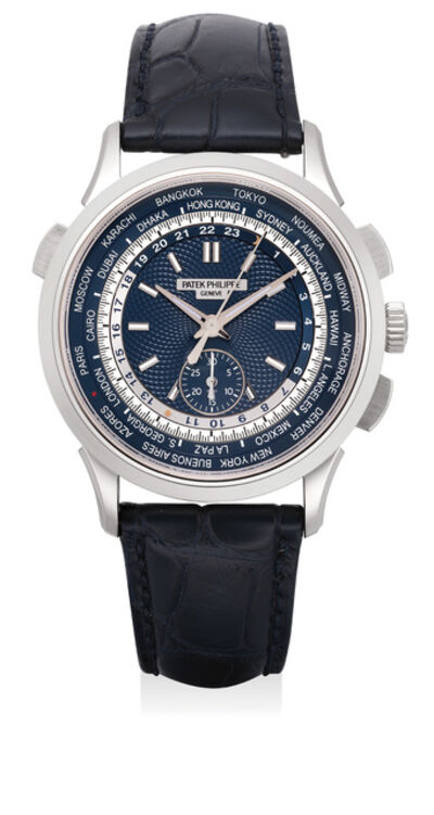 Patek Philippe, 'A rare and attractive white gold world time flyback chronograph wristwatch with blue guilloché dial, 24-hour and day-night indication, with Certificate of Origin and presentation box', 2016