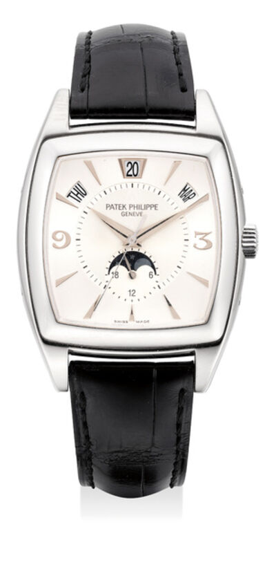 Patek Philippe, 'A fine and rare white gold annual calendar wristwatch with center seconds, moon phases, certificate and box', Circa 2005