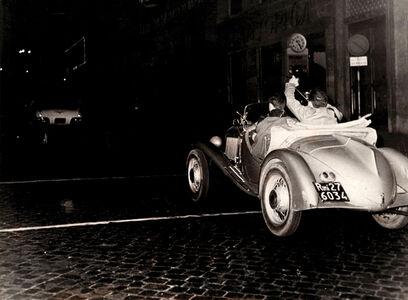 Tazio Secchiaroli, 'The photohraphers rlo Bavagnoli and Enrico Sarsini chasing Ava Gardner's car after got a flat tire'