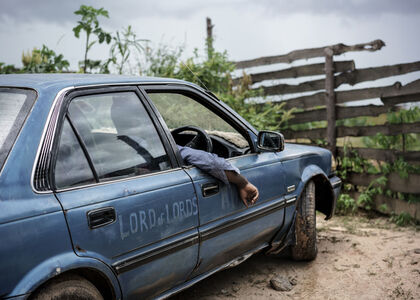 Jonas Bendiksen, 'The Jesus of Kitwe in one of his two Toyota Corollas. Kitwe, Zambia. ', 2016