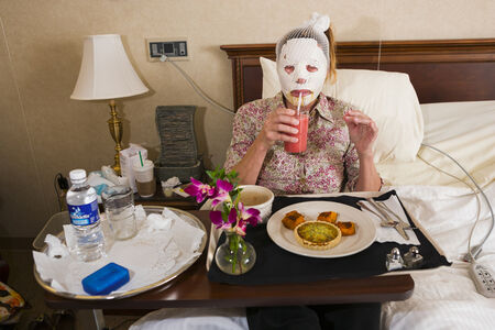 Lauren Greenfield, 'Dr. Steven Teitelbaum's forty-nine-year-old patient, who is recovering from a full-face laser resurfacing and an upper eye lift, eats lunch in a private room at Serenity, a luxury aftercare facility that offers private chefs, spa treatments, and twenty-four-hour nursing, Santa Monica, California', 2006