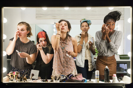 Lauren Greenfield, 'High school seniors (from left) Lili, 17, Nicole, 18, Lauren, 18, Luna, 18, and Sam, 17, put on their makeup in front of a two-way mirror for the author's Beauty CULTure documentary, Los Angeles', 2011