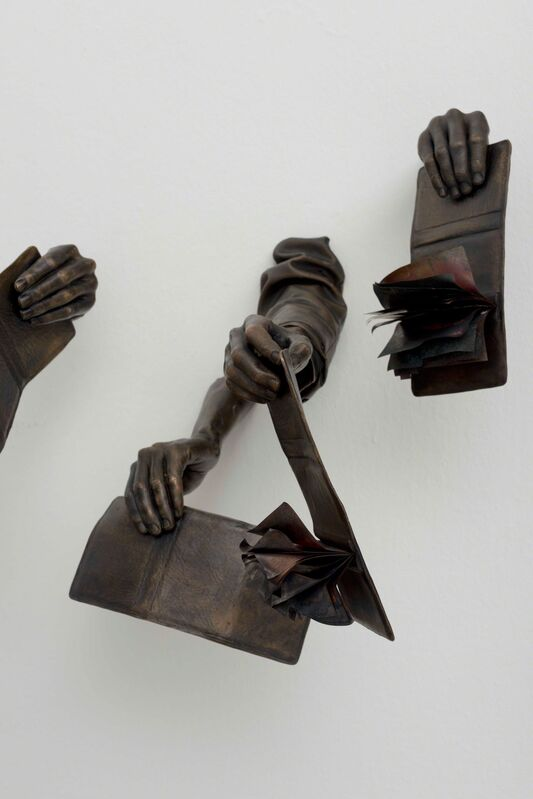 Hank Willis Thomas, 'Die Dompas Moet Brand! (The Passbook Must Burn!)', 2014, Sculpture, 7 life-cast arms holding pass books; Bronze and copper shim, Goodman Gallery