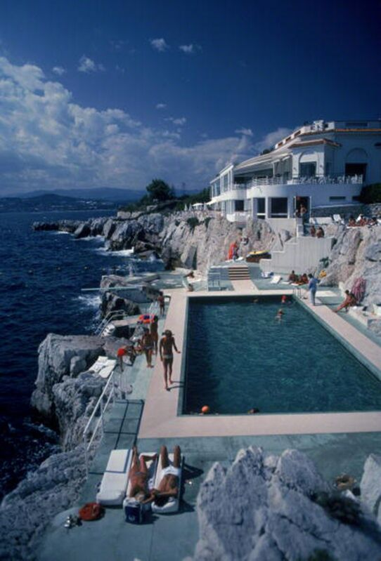 Slim Aarons, 'Eden Roc Pool: Guests by the pool at the Hotel du Cap Eden-Roc, Antibes, France', 1976, Photography, C-Print, Staley-Wise Gallery
