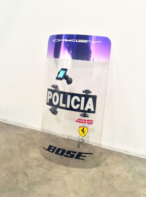 Juan Sebastián Peláez, 'Flex (ooh ooh ooh)', 2015, Installation, Escudo oficial de policia, stickers, porta-celluar y iphone, Carne