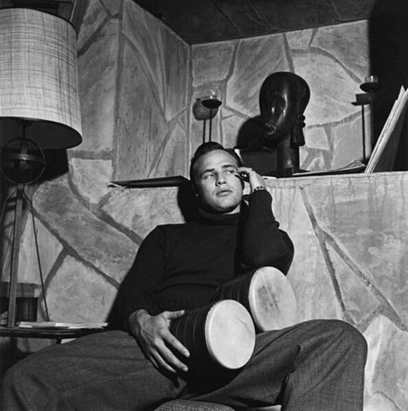 Sid Avery, 'Marlon Brando with bongo drums at his Beverly Hills home', 1955