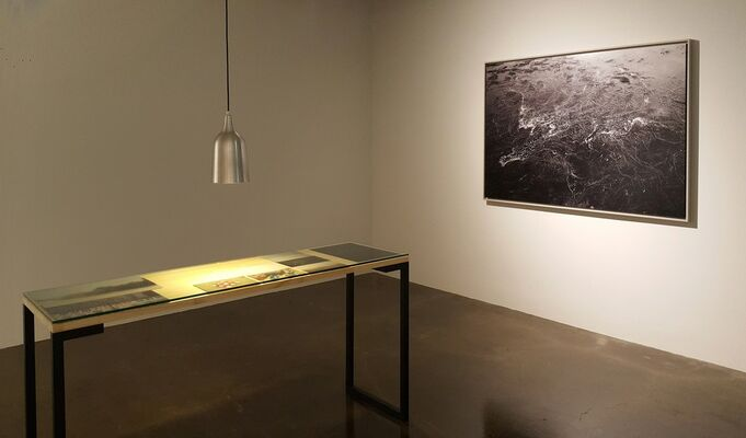 A shadow of the Moon swallows the Sun, installation view