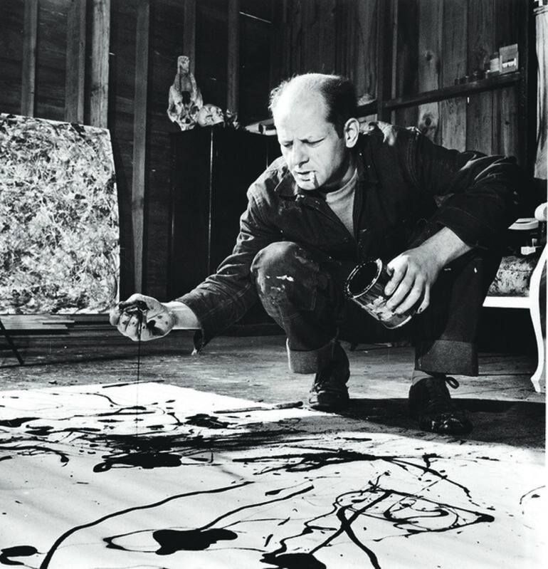 Martha Holmes, 'Artist Jackson Pollock Dribbling Sand on Painting While Working in his Studio', Photography, Dallas Museum of Art