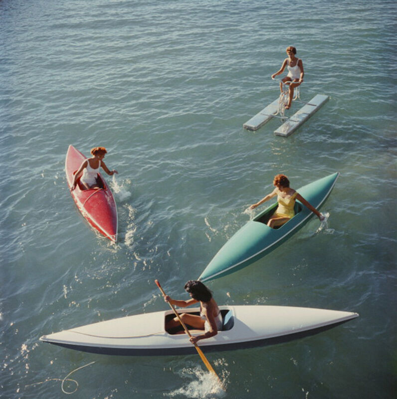 Slim Aarons, 'Lake Tahoe Trip, 1959: Young women canoeing on the Nevada side of Lake Tahoe', 1959, Photography, C-Print, Staley-Wise Gallery