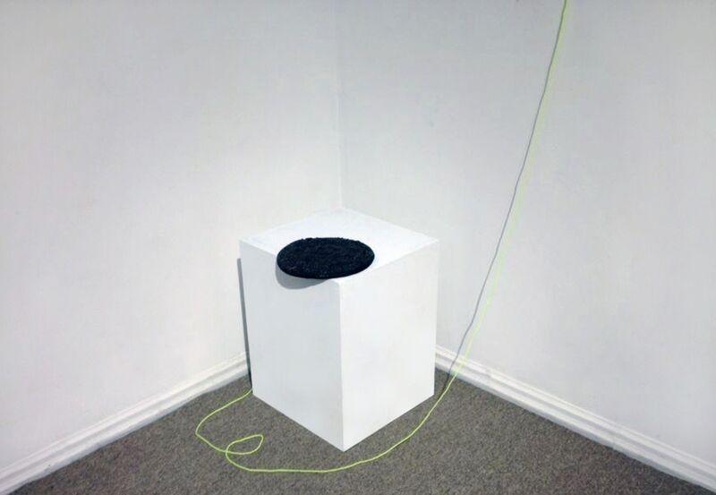 Oscar Figueroa, 'Path Around Burnt Pizza', 2014, Sculpture, Burnt pizza, nylon string, white plinth, carpet plinth, Robert Kananaj Gallery