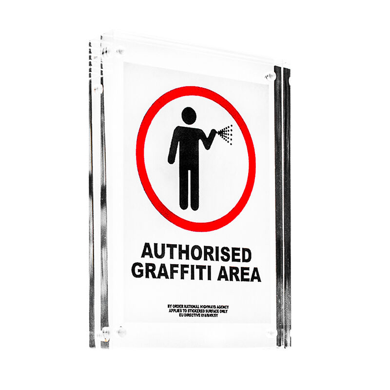 Banksy, 'AUTHORISED GRAFFITI AREA STICKER (Framed)', ca. 2004, Ephemera or Merchandise, Sticker printed in 2 colors on Starliner paper and float framed in new clear acrylic blocck frame., Silverback Gallery