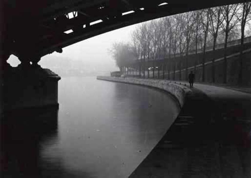 Willy Ronis, 'Man Walking along the Seine', 1960c