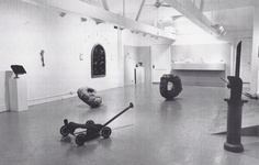 """Interior view of EHCCA, showing """"Relics,"""" 1988 (an exhibition featuring artists Steven Mignone, Louise Reiner, and Ruth Hardinger, among others.) Photo by Noel Rowe, courtesy of Arielle Tepper Madover & Hyphen."""