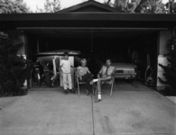 Bill Owens, Our house is built with the living room in the back, so in the evening we sit out front of the garage and watch the traffic go by, 1972. Courtesy of Robert Koch Gallery.