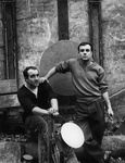 Jean Tinguely and Yves Klein in the courtyard at 9-11 Impasse Ronsin with their collaborative works Excavatrice de l'espace and La Vitesse total, 1958. Photo © Martha Rocher / Bibliothèque Kandinsky - Centre Pompidou. Yves Klein and Jean Tinguely artwork © ADAGP, Paris/Artists Rights Society (ARS), New York.Photo courtesy of Paul Kasmin Gallery.