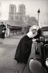 Nun in front of Notre-Dame, Paris.