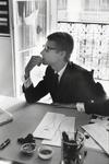 Yves Saint Laurent à sa table de travail (Yves Saint Laurent at his desk) Paris, 1964