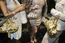 Jackie and friends with Versace handbags at a private opening at the Versace store, Beverly Hills