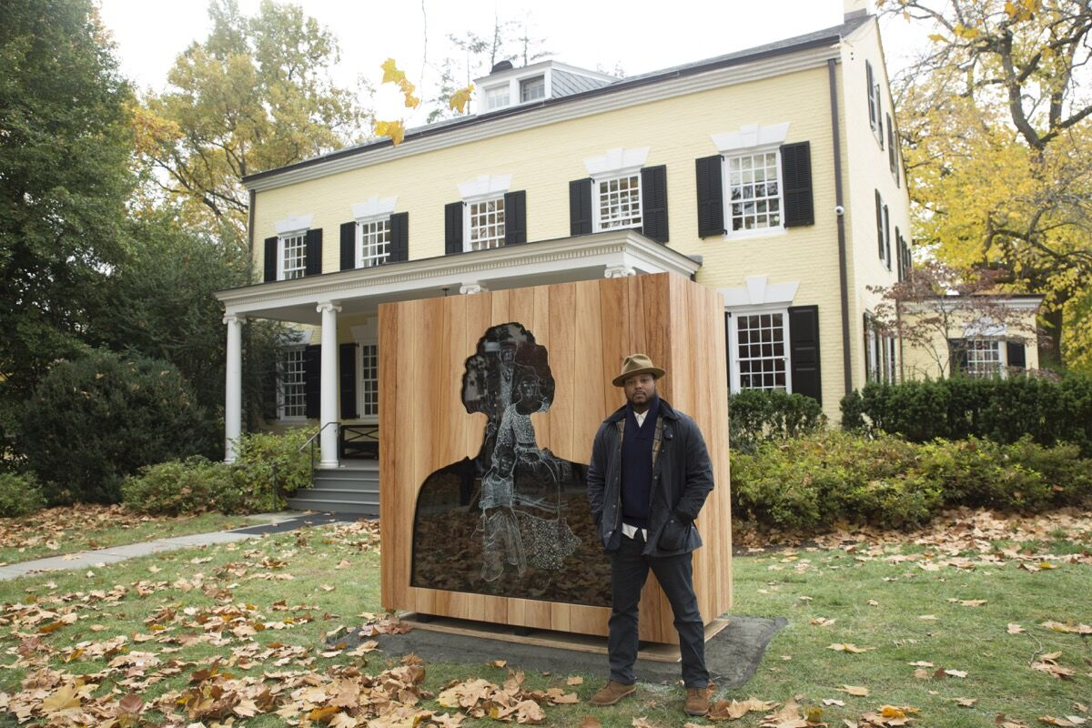 Titus Kaphar stands next to his commission for Princeton University, Impressions of Liberty (2017). Courtesy of Princeton University Art Museum.
