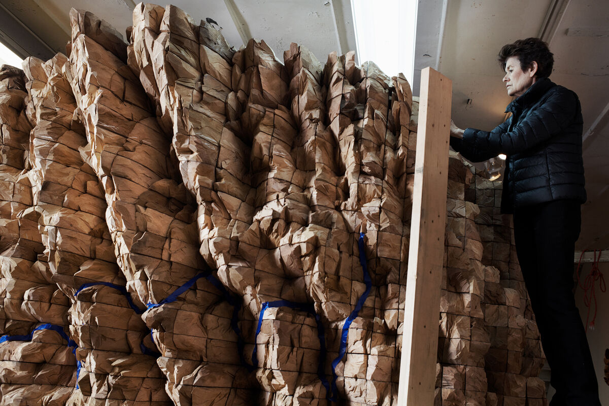 Portrait of Ursula von Rydingsvard with an in-progress sculpture. Photo by Alex John Beck for Artsy.