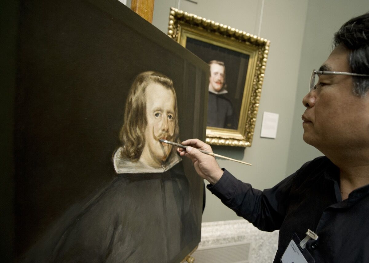 Chinese painter Yang Fei Yun works on a copy of Velazquez's painting Portrait of Felipe IV at the Prado Museum in Madrid on January 25, 2013. Photo: DOMINIQUE FAGET/AFP/Getty Images.