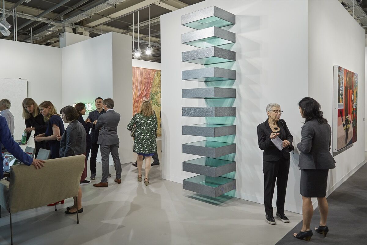 Installation view of David Zwirner's booth at Art Basel, 2016. Photo by Benjamin Westoby for Artsy.