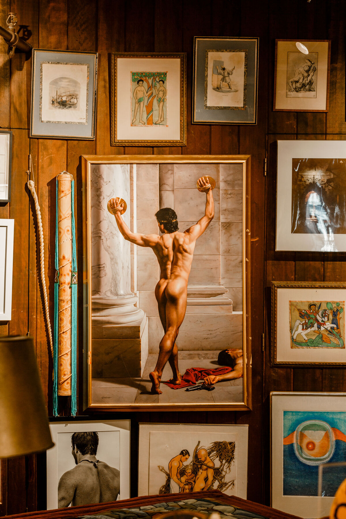 Victor Gadino's classically-inflected Dionysus (1997) holds pride of place on a salon-style wall facing Leslie's bed. Photo by Max Burkhalter for Artsy.