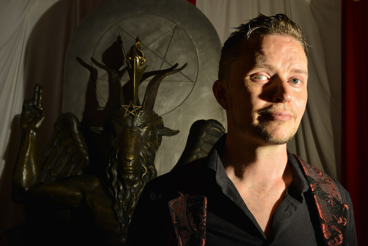 Lucien Greaves, spokesman for the Satanic Temple, with a statue of Baphomet at the group's meeting house in Salem, Massachusetts. Photo by Josh Reynolds for The Washington Post via Getty Images.