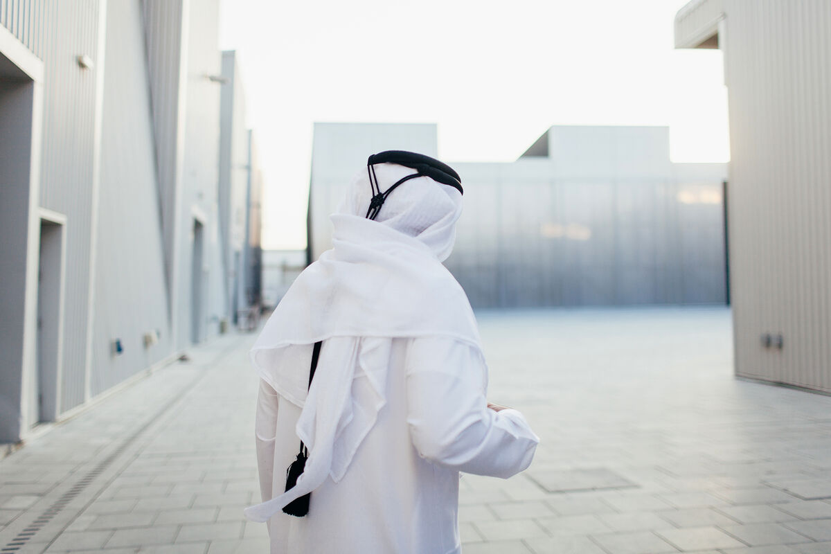 Portrait of Abdelmonem Bin Eisa Alserkal standing outside of the OMA-designed space, Concrete, on Alserkal Avenue, Dubai, by Anna Maria Nielsen for Artsy.