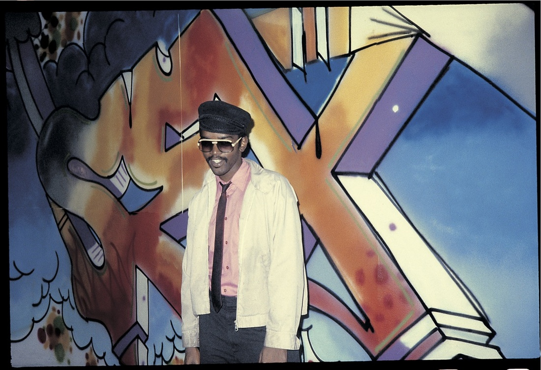 "Charlie Ahearn, Image of Fab 5 Freddy in front of one of his paintings, 1980. Image will be on view at PPOW's forthcoming exhibition, ""Charlie Ahearn Scratch Ecstasy"" May 18 - Jun 24. Courtesy of the artist."