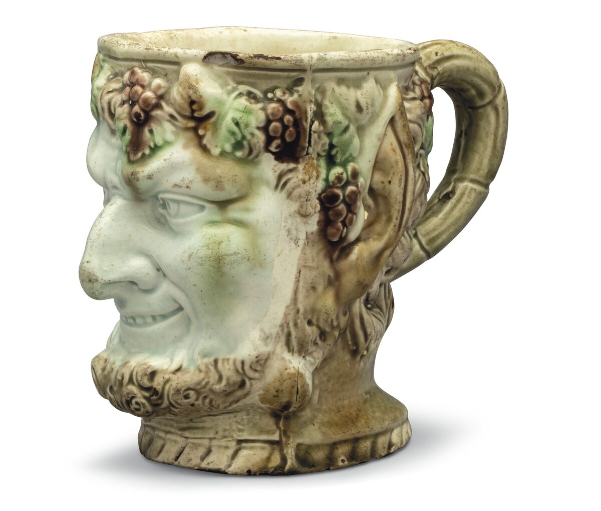 A Staffordshire creamware satyr-mask mug, c. 1770. Courtesy of Christie's.